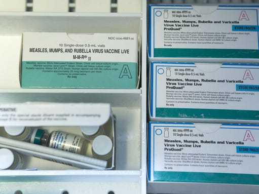The measles-mumps-rubella vaccine, seen here, is administered
