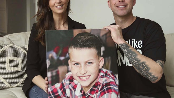 "Joanna Ward and Ryan Ward hold a photograph of their son James, 10, in Jackson Township. James went to sleep March 11, 2019 and did not wake up the next morning. His unexplained death is called Unexplained Death in Childhood similar to Sudden Infant Death Syndrome (SIDS) in infants. Ryan wrote a song for his son who left a positive impression on many people's lives. There is also a Facebook page called ""Smile Like James."""