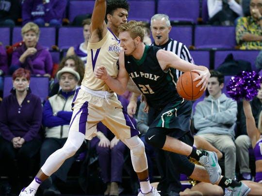 Cal Poly forward Luke Meikle drives around Washington forward Matisse Thybulle, left, during the first half of an NCAA basketball game, Tuesday, in Seattle.