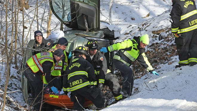 Emergency personnel free a woman trapped in her car after an accident on Stewart Road just north of Piper Road on Monday morning.