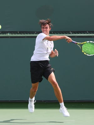 Alex Kuperstein hits during his win over Connor Rapp during the boy's DVL tennis finals in Indian Wells, April 26, 2016.