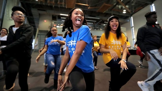 Kennedy Glover (center) and Jadyn Cobb (right) join fellow Memphis-area teens for a session of flash-mob training this weekend at Bridge Builders headquarters Downtown in preparation for a series of city-wide flash mobs to boost voter turnout among young people.