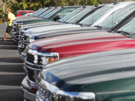 David Stepniak, who works as the new car lot manager at Roger Dean Chevrolet in Cape Cape Coral, says lower gas prices have resulted in greater interest in larger vehicles including trucks and SUVs. Roger Dean Chevrolet has more Chevy Tahoes on order after selling half a dozen in the last few months.