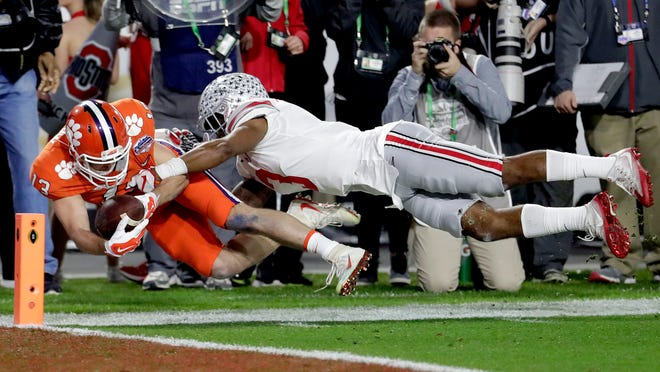 Clemson wide receiver Hunter Renfrow (13) is tackled short of the goal line by Ohio State cornerback Damon Arnette (3) during the first half of the Fiesta Bowl NCAA college football game, Saturday, Dec. 31, 2016, in Glendale, Ariz. (AP Photo/Rick Scuteri)