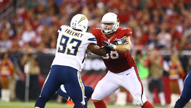Sep 8, 2014: San Diego Chargers linebacker Dwight Freeney (left) against Arizona Cardinals offensive tackle Jared Veldheer at University of Phoenix Stadium. The Cardinals defeated the Chargers 18-17.