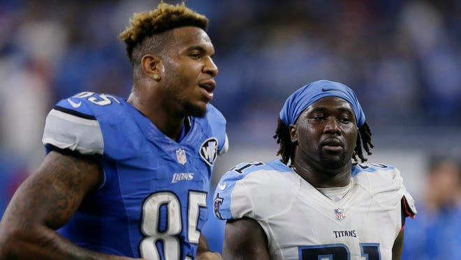 Lions tight end Eric Ebron and Titans safety Da'Norris Searcy walk off the field after their game, Sunday, Sept. 18, 2016, in Detroit. The Titans won, 16-15.
