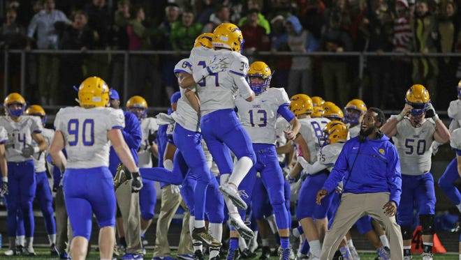 Carmel defenders celebrate a big play in the Greyhounds win over Hamilton Southeastern on Friday.