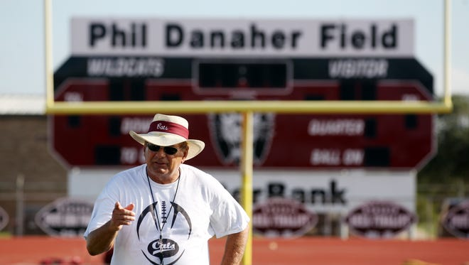Calallen head coach Phil Danaher leads his players through practice Friday, Aug. 8, 2014 at Calallen High School in Corpus Christi.