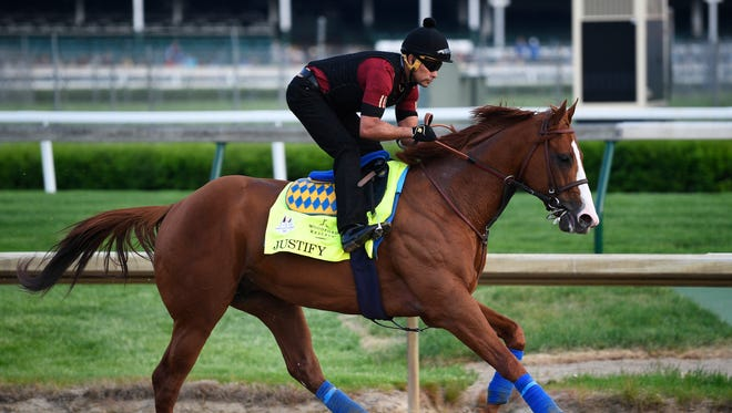 An exercise rider works out Kentucky Derby entry Justify at Churchill Downs.