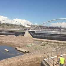 A smelly muck has continued to pool up at Tempe Town Lake's western rubber dam since last week's historic rainstorm battered Arizona cities and carried storm-water runoff and debris into the lake.