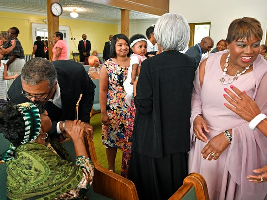 During a time of greeting Rev. Morris E. Tipton leans down and kisses the forehead of Annie James as Sonia English-Shaw, right, greets other members of the First Baptist East Nashville, Sunday July 16, 2017. The church is in a time of transition because the neighborhood has changed around them and they're trying to reach it. Next door is a big high rise apartment building and behind them is Section 8 housing — two different demographics within the block.