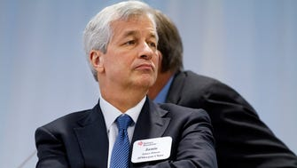 JPMorgan Chase Chairman and CEO Jamie Dimon listens as President Barack Obama speaks to leading CEOs to discuss ways to promote the economy and create jobs during the president's last two years in office, Wednesday, Dec. 3, 2014, at the Business Roundtable Headquarters in Washington. (AP Photo/Jacquelyn Martin) ORG XMIT: DCJM109