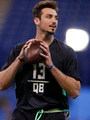 Former Memphis Tigers quarterback Paxton Lynch throws  a pass during the 2016 NFL Scouting Combine.