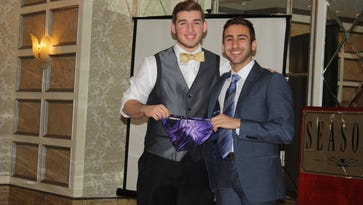 From 2015: The purple speedo is passed down at the River Dell/New Milford swim banquet. That's Steven Akdemir handing the prized possession to Julian Smith.