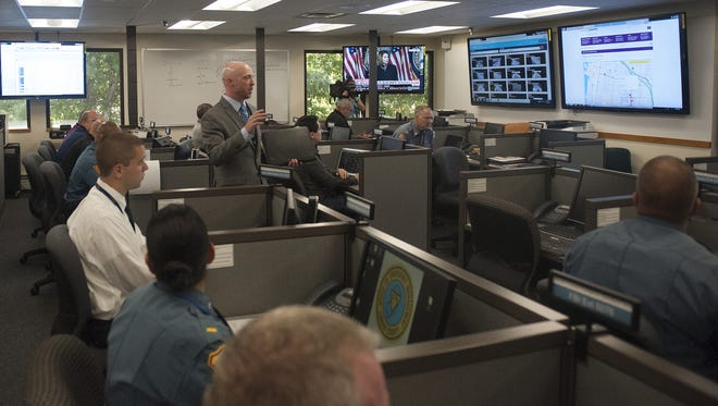 Camden County spokesman Dan Keashen explains address the media and city officials during a visit to the Camden County department of Public Safety. The department will be hosting a central command unit during the Papal visit.