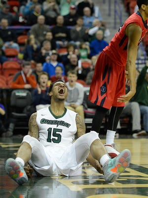 UW-Green Bay's Greg Mays (15) screams with emotion after getting fouled while dunking the ball against Detroit during Wednesday night's Horizon League game at the Resch Center in Ashwaubenon. Evan Siegle/Press-Gazette Media