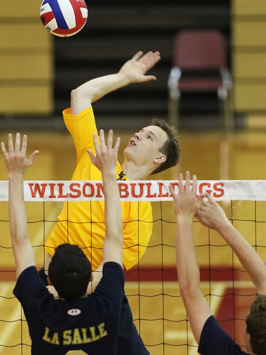 Penn Manor's Noah Leichliter (16) puts the ball over the net against LaSalle College during game action in the opening round of the PIAA 3A boys volleyball tournament at Wilson High School Wednesday May 27, 2015. Chris Knight