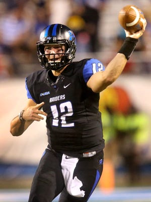 MTSU's Brent Stockstill (12) drops back to pass during the first half of an NCAA college football game against Charlotte Saturday, Sept. 19, 2015, in Murfreesboro.