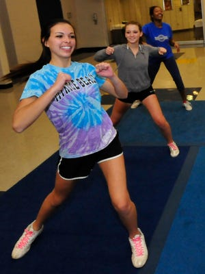 Cheerleaders Savannah Smith, front, Tina Martinez and Alika Benjamin practice routines after school Thursday, Nov. 12, 2015 at Waynesboro Area Senior High School. Nine students will get a chance to perform during the Macy's Thanksgiving Day Parade.