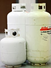 Propane tanks are displayed during a press conference regarding the arrest and  charges being filed against Howard Timothy Cofflin Jr., at the Pennsylvania State Police Department in Loganville, Pa. on Wednesday, Jan. 6, 2016. Cofflin was charged based on evidence found, including the tanks, and threats made regarding his intention to kill his ex-girlfriend, Pennsylvania State Troopers and county judges. (Dawn J. Sagert - The York Dispatch)