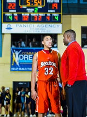 Denzel Valentine, left, appears to get little sympathy from his father and Sexton coach Carlton Valentine after picking up his second foul in the second quarter of a game at Lansing Eastern in 2012.