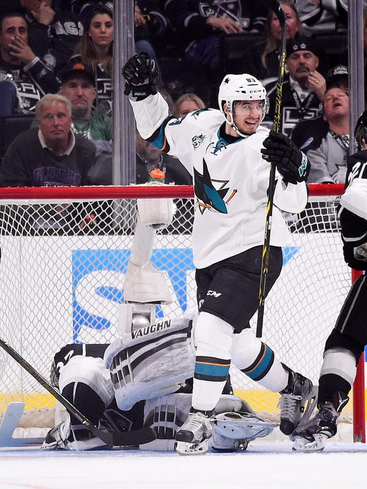 San Jose Sharks left wing Matt Nieto celebrates his goal on Los Angeles Kings goalie Jonathan Quick during the second period of Game 5 in an NHL hockey Stanley Cup playoffs first-round series, Friday, April 22, 2016, in Los Angeles. (AP Photo/Mark J. Terrill)