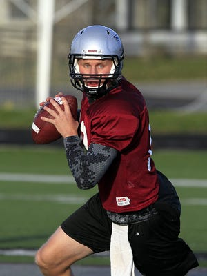 Former Central Catholic and University of Indianapolis quarterback Chris Mills, shown here in 2013, recently drew unexpected interest from a Canadian Football League team after his performance at Purdue's Pro Day.