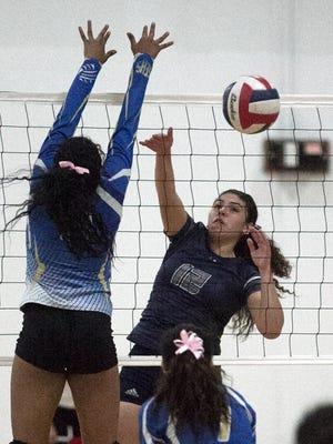 Myranda Manriquez, 12, of Mountain View gets a shot past Lorena Ituarte, 9, of San Elizario on Tuesday night.