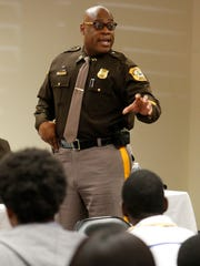 "New Castle County Police Captain Quinton Watson offers the police perspective of traffic stops during the ""Pullover Etiquette"" forum with public and police representatives Saturday in Wilmington."