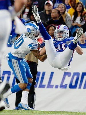 Lions cornerback Teez Tabor tackles the Bills' Keith Towbridge in the first half Thursday, Aug. 31, 2017 in Orchard Park, N.Y.