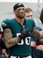 Philadelphia Eagles' Chris Long (56) is shown during the National Anthem before an NFL football game against the Arizona Cardinals in Philadelphia.