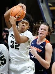 Ae'Rianna Harris of Purdue pulls down a rebound in front of Alex Wittinger of Illinois Wednesday, February 21, 2018, at Mackey Arena. Purdue defeated Illinois 64-51.