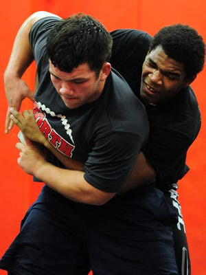 North Salem senior wrestlers Sam Hirons (left) and Cameron Harris during practice at the school on Monday, December 15, 2014.