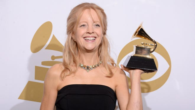 """Maria Schneider poses in the press room with the award for best contemporary classical composition for """"Schneider, Maria: Winter Morning Walks"""" at the 56th annual GRAMMY Awards at Staples Center on Jan. 26, 2014, in Los Angeles."""