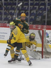 Hartland goalie Brett Tome, who made 28 saves, watches