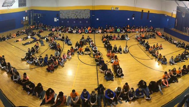 Student in Manville spelled out #SAFE as part of the national March 14 school walkout event.