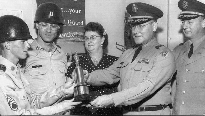 "Sgt. Robert S. Smyers, a local Ohio National Guard member, left, received the annual Capt. William Belhorn ""Soldier of the Year"" award in May 1959 at the Sherman Armory. Others attending the ceremony, from left, include Capt. Raymond Heister, local Company G, 116th Combat Team Commander; Virgie Smyers, Smyers' mother; Maj. Earl F. Matthew; and an unidentified officer."
