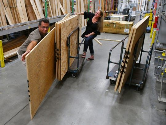 """""""We are crossing our fingers"""". says Wes and Davina Hardin of Palm Bay, buying plywood and other hurricane supplies on Labor Day Monday at the Melbourne Lowe's Home Improvement Store on Minton Road."""
