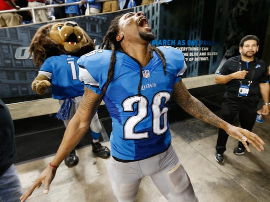 Louis Delmas (26) of the Detroit Lions celebrates a 40-32 victory over the Chicago Bears at Ford Field on September 29, 2013 in Detroit, Michigan.