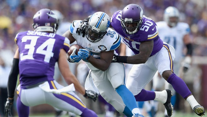 Joique Bell of the Detroit Lions carries the ball against Andrew Sendejo and Gerald Hodges, right, of the Minnesota Vikings during the second quarter Sept. 20, 2015, at TCF Bank Stadium in Minneapolis.