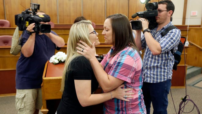 Breanne Brodak, left, and Cortney Tucker kiss after getting married in Pontiac, Mich., Friday, June 26, 2015, after The Supreme Court declared that same-sex couples have a right to marry anywhere in the United States.