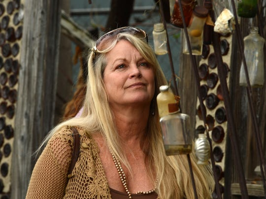 Pamela Staton, from Yachats, Oregon, looks at one of