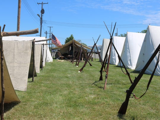 """Zach Davis and Don VanMeter, both of the 105th Ohio Volunteer Infantry, set up an authentic Civil War camp re-enactment at the Ottawa County Fairgrounds during """"Farm Fest"""""""