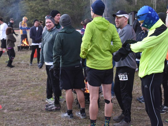 Wood fires warm up racers in the Swamp Trail races