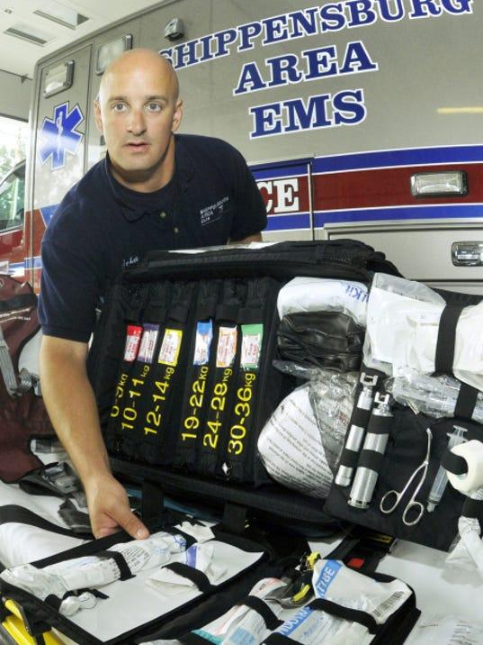 Paramedic John Rice displays the pediatric bag used on ambulance units Tuesday at Shippensburg Area Emergency Services.