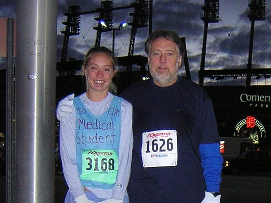 Katie McCabe and her father, Mick, pose in front of Comerica Park before the Detroit Marathon in 2002. It was Katie McCabe's first marathon.