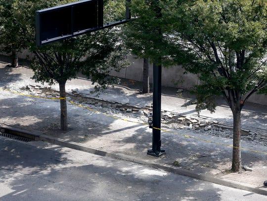 The sidewalk on Third Street, between Race and Elm
