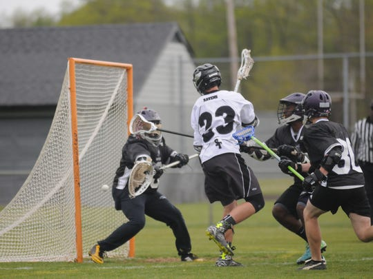 Sussex Tech freshman Nathan Quillin whips around the net to score against St. Thomas More on Friday in Georgetown.