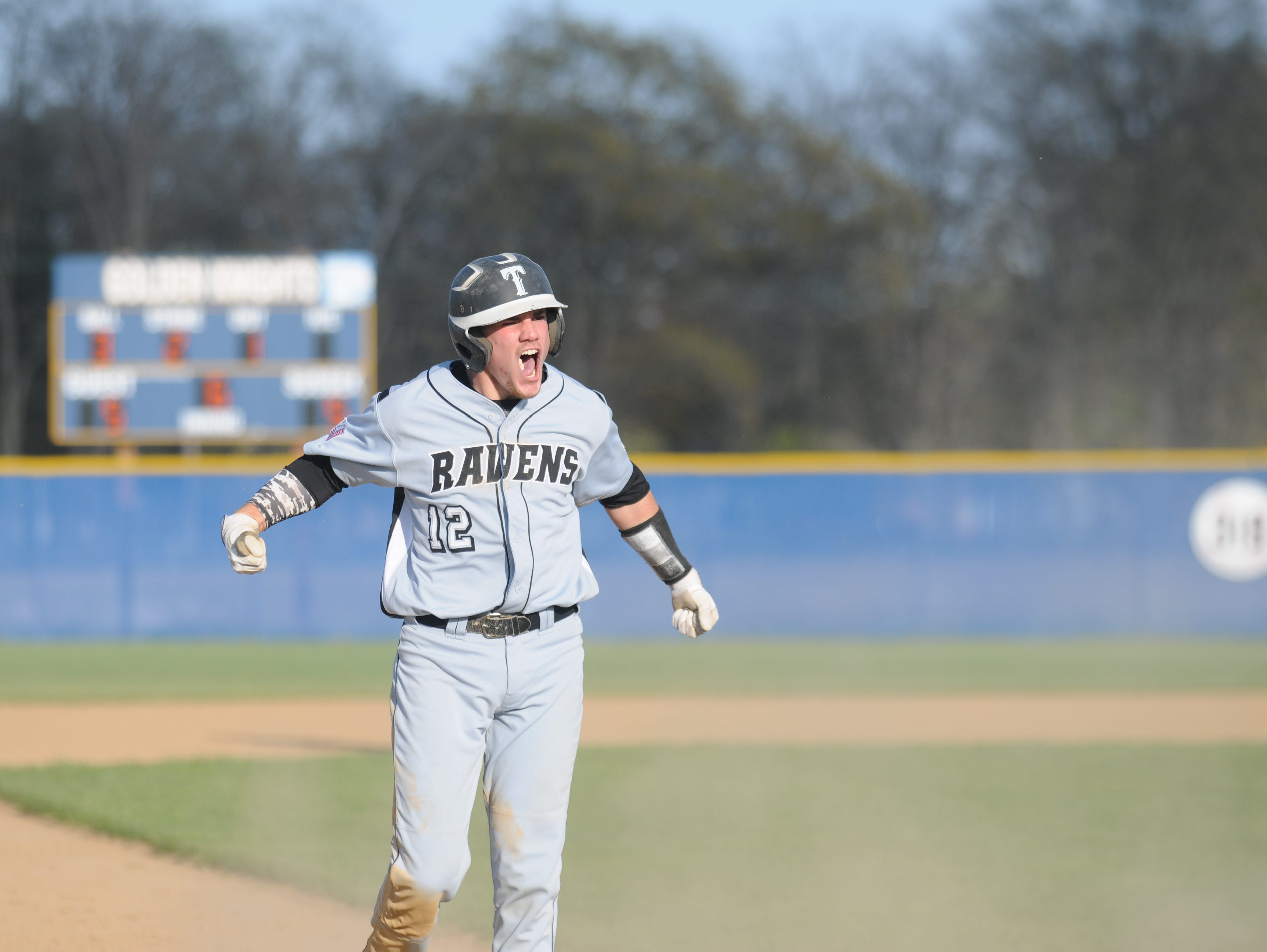 Sussex Tech's Colin Bergh pounds his chest after a triple that scored the go-ahead run in the sixth inning against Sussex Central in 2014.
