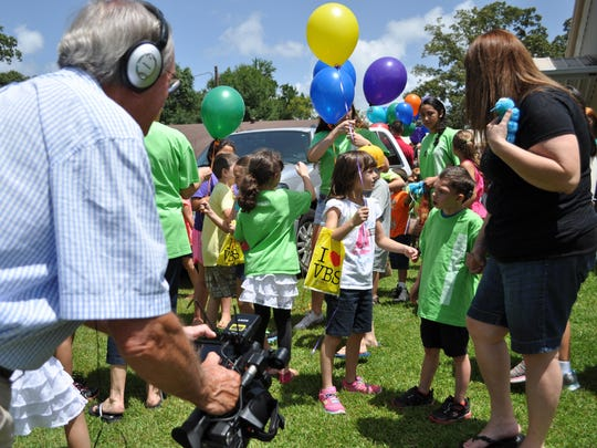 Ken Nelson, who is making a documentary about Hendrix Ebert's life for the Make-a-Wish Foundation, follows Hendrix with his camera during VBS at Elwood Baptist Church in Forest Hill.